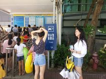Shenzhen, China: boys and girls go to the swimming pool to buy tickets and go swimming. In hot weather, boys and girls, together with their adults, go to the Royalty Free Stock Photos