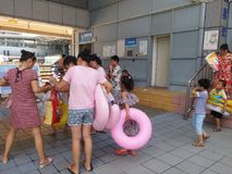 Shenzhen, China: boys and girls go to the swimming pool to buy tickets and go swimming. In hot weather, boys and girls, together with their adults, go to the Stock Photography