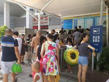 Shenzhen, China: boys and girls go to the swimming pool to buy tickets and go swimming Stock Photos