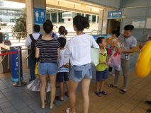Shenzhen, China: boys and girls go to the swimming pool to buy tickets and go swimming Royalty Free Stock Photo