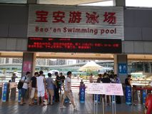 Shenzhen, China: boys and girls go to the swimming pool to buy tickets and go swimming. In hot weather, boys and girls, together with their adults, go to the Royalty Free Stock Photo