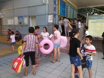 Shenzhen, China: boys and girls go to the swimming pool to buy tickets and go swimming Royalty Free Stock Image