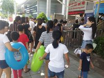 Shenzhen, China: boys and girls go to the swimming pool to buy tickets and go swimming. In hot weather, boys and girls, together with their adults, go to the Royalty Free Stock Image