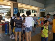 Shenzhen, China: boys and girls go to the swimming pool to buy tickets and go swimming Stock Images