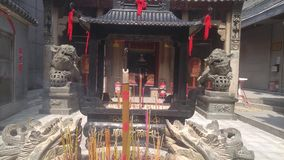 Shenzhen, China: burn incense and worship Buddha in the temple. Burn incense and worship Buddha in the temple. Xixiang beidi temple in shenzhen, China stock video footage