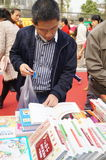 Shenzhen, China: buy books. Shenzhen Baoan Shopping Festival, people in the purchase of books Stock Photography