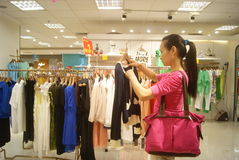Shenzhen, China: buy clothing Stock Images