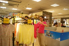 Shenzhen, China: buy clothing Stock Image