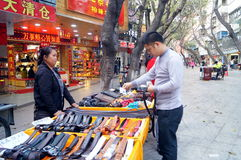 Shenzhen, China: buy leather belt Royalty Free Stock Photography