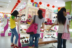 Shenzhen, China: buy shoes in the shoe store Royalty Free Stock Image