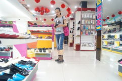 Shenzhen, China: buy shoes in the shoe store Stock Images