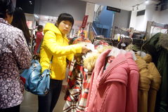 Shenzhen, china: buy winter clothes Royalty Free Stock Photo