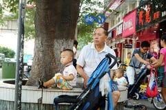 Shenzhen, China: care for grandchildren Royalty Free Stock Photos