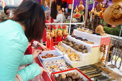 Shenzhen, China: carving crafts sales Royalty Free Stock Photos