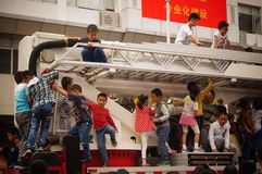 Shenzhen, China: children climbed up the fire truck Royalty Free Stock Photos