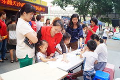 Shenzhen, China: children painting sale to help the people in trouble Royalty Free Stock Photo