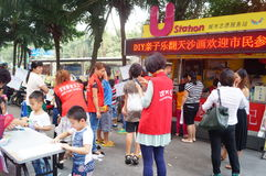 Shenzhen, China: children painting sale to help the people in trouble Stock Photos