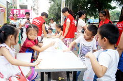 Shenzhen, China: children painting sale to help the people in trouble Royalty Free Stock Photography