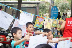 Shenzhen, China: children painting sale to help the people in trouble Royalty Free Stock Images