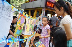 Shenzhen, China: children painting sale to help the people in trouble Stock Photo