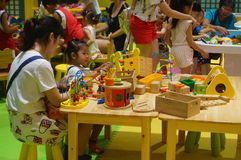 Shenzhen, China: children play games Royalty Free Stock Photography