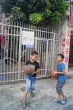 Shenzhen, China: children playing basketball Royalty Free Stock Photos