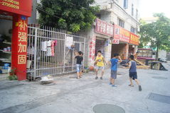 Shenzhen, China: children playing basketball Royalty Free Stock Photography