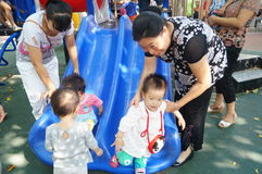 Shenzhen, China: the children are playing in the park Stock Photos