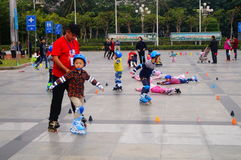 Shenzhen, China: children practice roller skating Stock Images