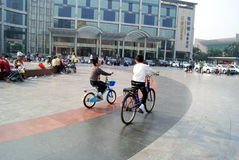 Shenzhen china: children ride a bike Royalty Free Stock Photo