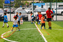 Shenzhen, China: Children's basic skills in the training of football. Baoan Shenzhen Sports Center, a group of children in the basic skills of training football royalty free stock images