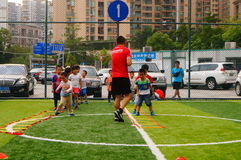 Shenzhen, China: Children's basic skills in the training of football. Baoan Shenzhen Sports Center, a group of children in the basic skills of training football royalty free stock photography