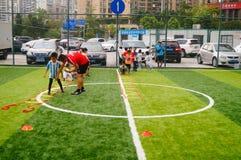 Shenzhen, China: Children's basic skills in the training of football. Baoan Shenzhen Sports Center, a group of children in the basic skills of training football royalty free stock photo