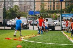 Shenzhen, China: Children's basic skills in the training of football. Baoan Shenzhen Sports Center, a group of children in the basic skills of training football stock photos