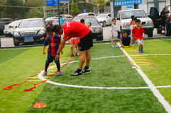 Shenzhen, China: Children's basic skills in the training of football Royalty Free Stock Photo