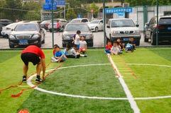 Shenzhen, China: Children's basic skills in the training of football. Baoan Shenzhen Sports Center, a group of children in the basic skills of training football stock photo