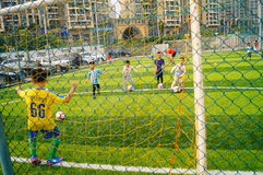 Shenzhen, China: Children's basic skills in the training of football. Baoan Shenzhen Sports Center, a group of children in the basic skills of training football stock photography