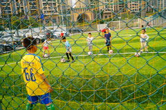 Shenzhen, China: Children's basic skills in the training of football Stock Photography