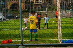 Shenzhen, China: Children's basic skills in the training of football Stock Images