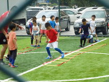 Shenzhen, China: Children's basic skills in the training of football. Baoan Shenzhen Sports Center, a group of children in the basic skills of training football royalty free stock photos