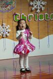 SHENZHEN, CHINA, 2011-12-23: Chinese child in flower costume per Royalty Free Stock Photography