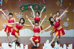 SHENZHEN, CHINA, 2011-12-23: Chinese kindergarten teachers perfo Stock Photos