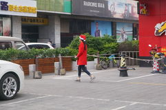 Shenzhen, China: Christmas, young women wearing Santa Claus costume Royalty Free Stock Images