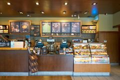 Starbucks. SHENZHEN, CHINA - CIRCA OCTOBER, 2015: inside Starbucks coffee shop in Shenzhen. Starbucks Corporation is an American coffee company and coffeehouse royalty free stock photography