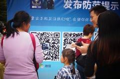 Shenzhen, china: citizens scanning police public micro signal Royalty Free Stock Photo