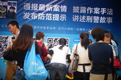 Shenzhen, china: citizens scanning police public micro signal Royalty Free Stock Photography