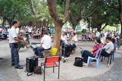 Shenzhen, China: citizens singing Entertainment Stock Photos