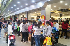 Shenzhen, China: clothing store crowded shopping Royalty Free Stock Images