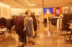 Shenzhen, China: clothing store interior landscape, newly listed clothing Stock Photos