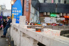Shenzhen, China: Commercial Street on the fence to be discarded are chowhound paper bowl Stock Photography
